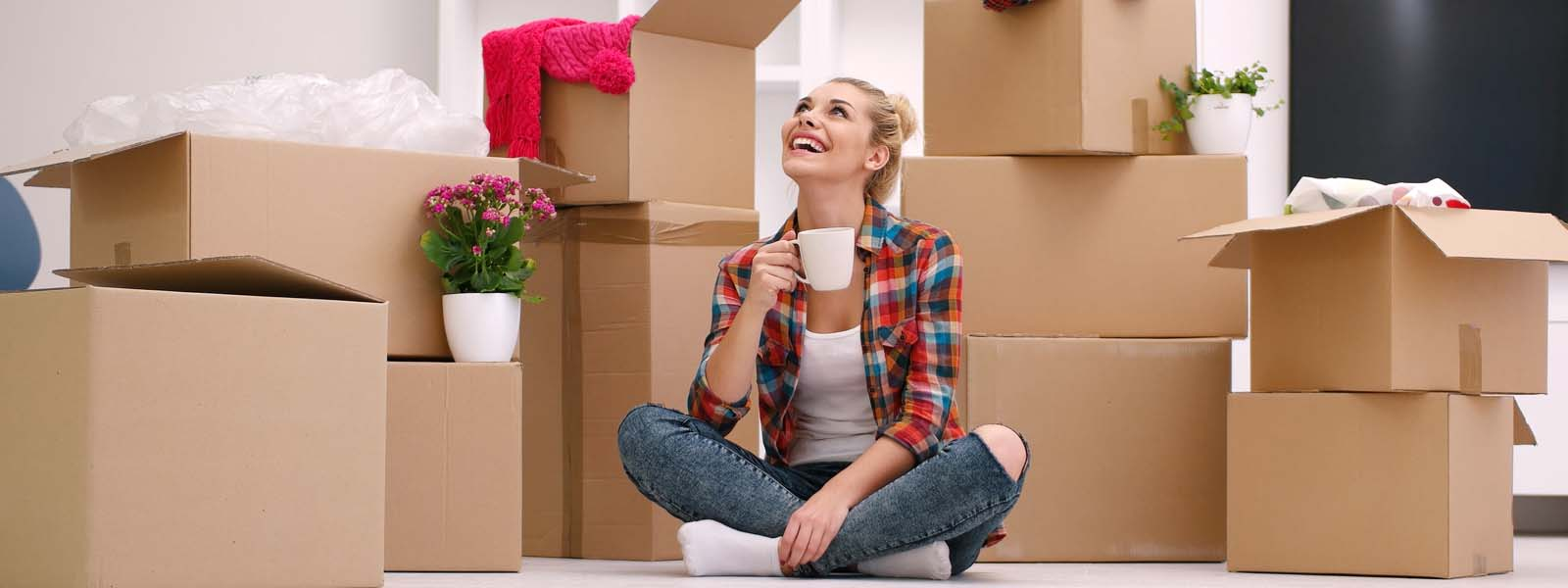 Girl sitting amoungst moving boxes